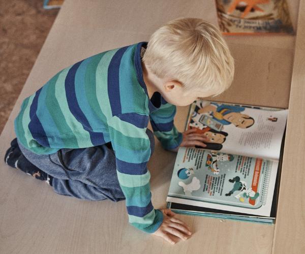 Boy reading book 600 x 500