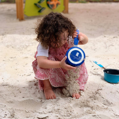 Girl playing with sand 400 x 400