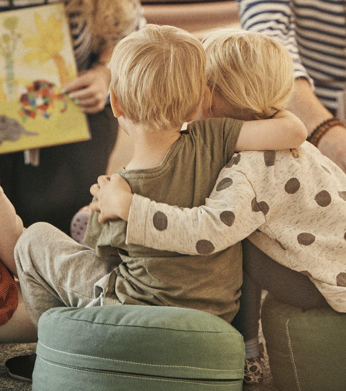 Sharing a hug at HEI Schools Jätkäsaari.